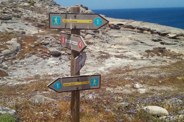 Signs on the hiking trails at the rocky landscape of «Paros Park».