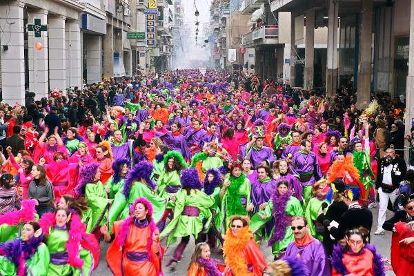 A colorful carnival parade marches in a central street of Patras.