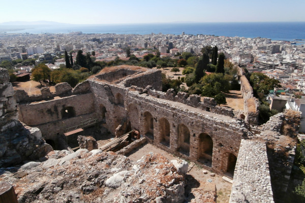 An overview of the remains of the Patras castle with the view of the city and the sea in the background.