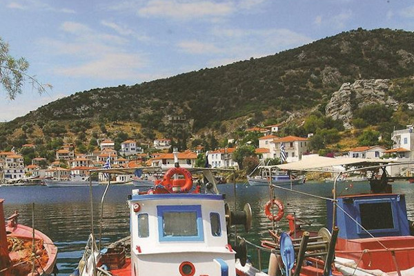 A part of Agia Kyriaki village in South Pelion including the port and some small fishing boats.