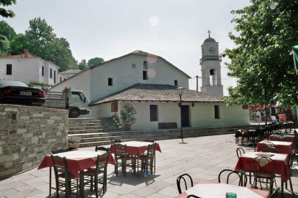 An image showing a part of the village square and the Church of Taxiarches in Milies of Pelion.
