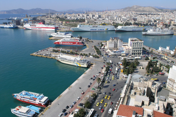 An aerial photo of the Port of Piraeus with many ships anchored by the docks.