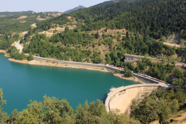 An overview of the Plastiras Lake Dam with a part of the surrounding mountains.