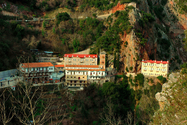 A picture of the Monastery of Prousou that is built at the cliffs of the mountain.