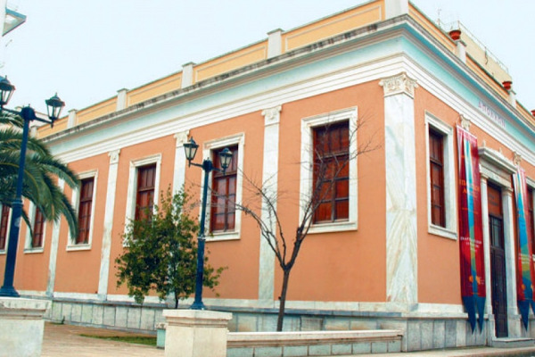The exterior of the neoclassical building that hosts the Apollo Theater of Pyrgos.