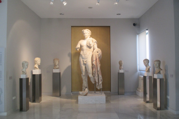 The big statue of the Roman emperor Trajan in a room of the Archaeological Museum of Pythagorio.