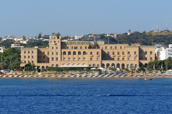 A picture taken by the sea showing the front side of the building of the Casino «Rodos».