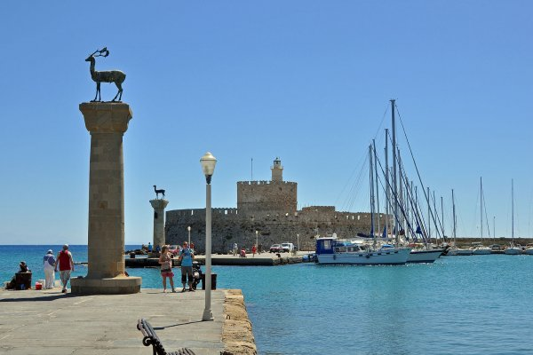 The entrance of the Mandraki Port of Rhodes island with the famous deer statues.