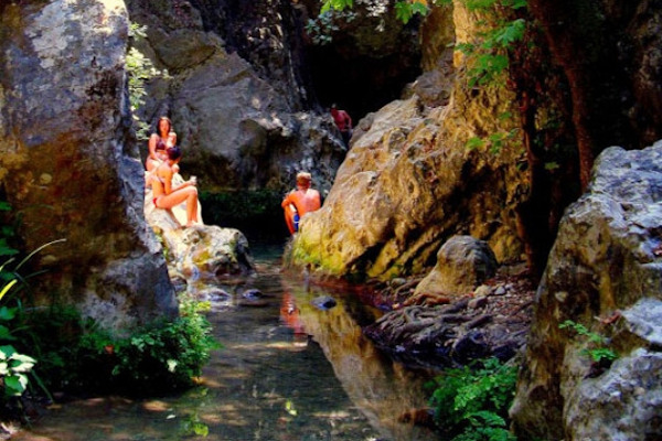People enjoying and swim in the waters of the Potami Waterfalls of Samos.