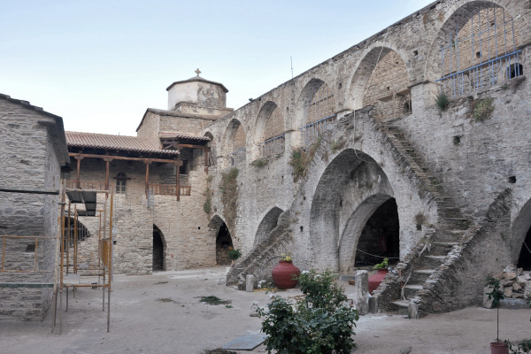 The inner yard of stone-built monastery links with a terrace by elegant stairs wrapped around an arched gate.