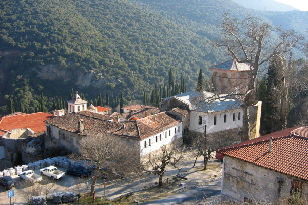 A panoramic picture of the Timiou Prodromou monastery facilities surrounded by the green natural landscape.