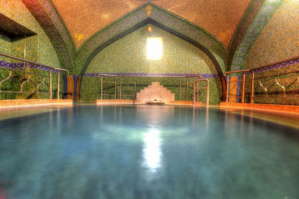 The interior of the hall that hosts the warm pool and is characterized by the beautiful mosaic walls.