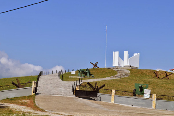 The memorial structure and other front battle remnants on the top of the Fort Roupel hill.