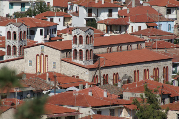 An overview and a close up at the church of Agios Nikolaos that is situated among the houses of the homonymous village in Halkidik