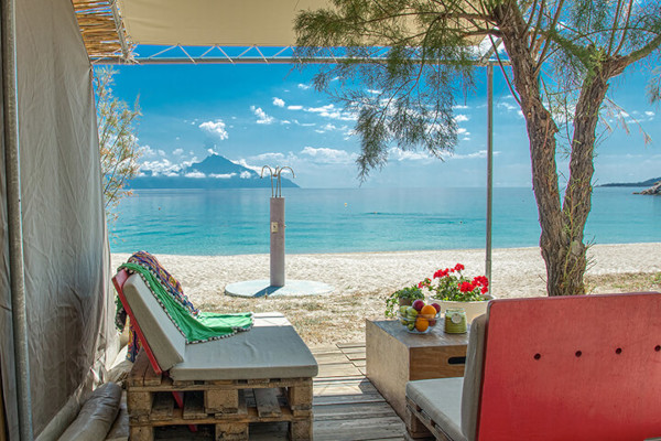 A photo taken from one of the Bungalows of Armenistis Camping with the great view of the beach and the Mount Athos.