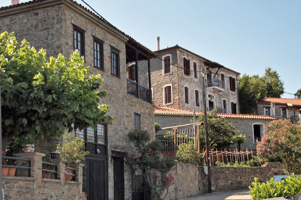 Some traditional stone-built traditional houses by a street of Parthenonas village in Halkidiki.