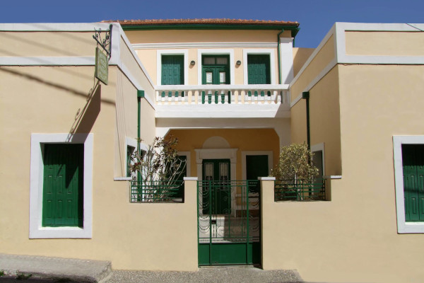 A picture of the exterior, the front yard, and the main entrance of the Folk Historical Museum of Sitia.