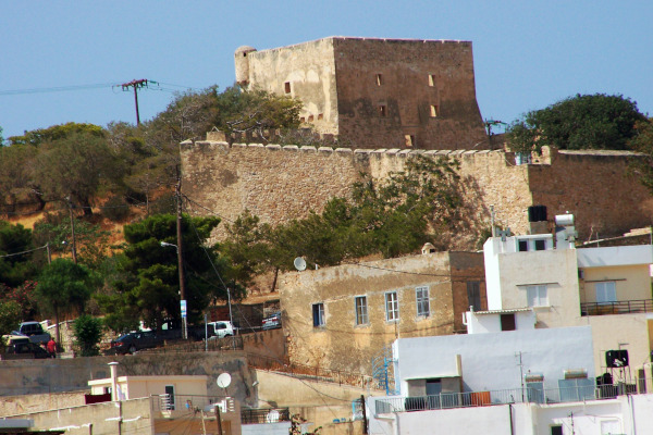 A picture of the brown-stone Kazarma Fortress above the residential area in Sitia.
