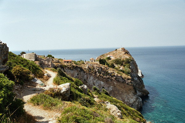 Picture showing the steep cliffs of the rocky peninsula of the Medieval Castle of Skiathos.