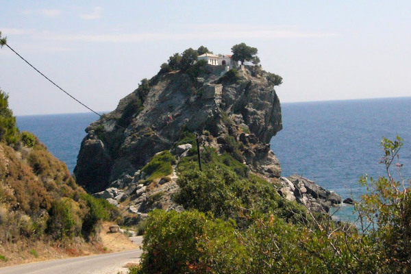 A picture showing the huge rock where the Chapel of Agios Ioannis of Kastri in Skopelos is located.