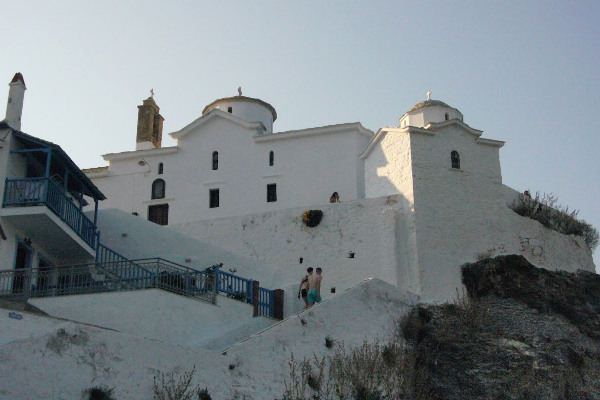 The white Church of the Virgin Mary (Panagitsa Tower) and the steps leading to it.