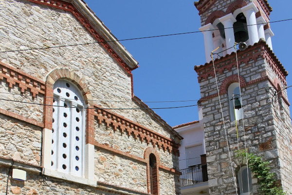 A picture showing a part of the exterior and the belfry of the main church of St. Riginou Monastery.