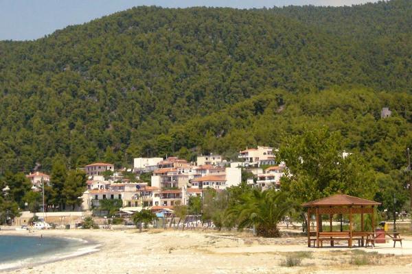 The coastline village of Neo Klima (Elios) of Skopelos among the dense vegetation.
