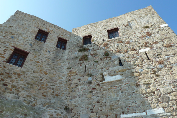 The high stone-built walls that surround the St. George Monastery of Skyros.