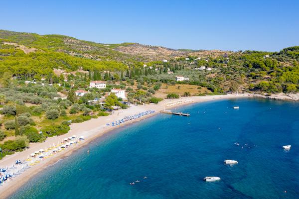 An aerial photo of the Agii Anargiri beach on the island of Spetses