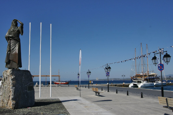 A photo showing the Bouboulina's Statue in Spetses Port.