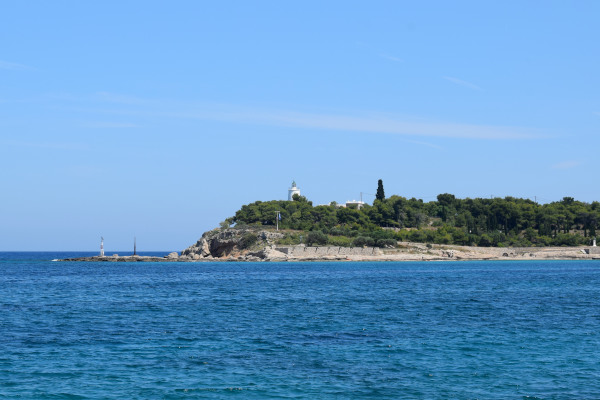 A Picture of the peninsula that hosts the Lighthouse of Spetses on its edge.