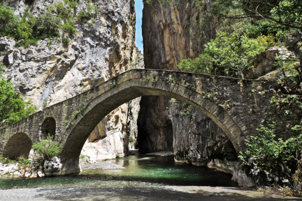 The stone bridge of Portitsa with the canyon in the background.