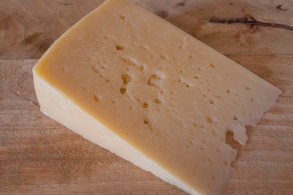 A local product of Syros, the San Michali yellow cheese, sitting on a table.