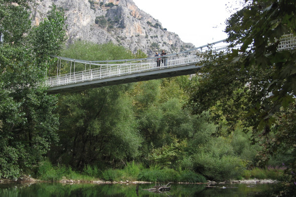 Suspension bridge in Tempi Valley, that connects one bank of the Pinios River with the of Shrine of Agia Paraskevi area.