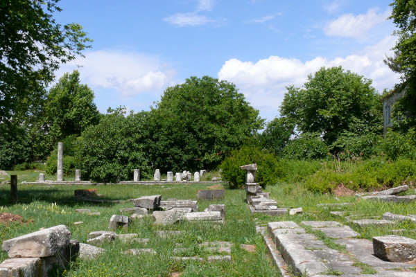 Some visible foundations of buildings and temples as remnants of the Thasos Ancient Agora.