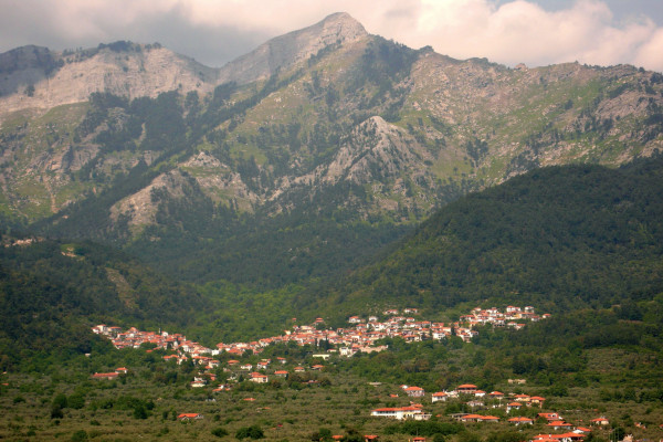 A panoramic picture showing the village of Potamia at the foothills of mount Ypsario.