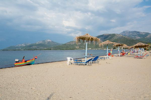 A photo of a sandy beach of Prinos on Thasos island.