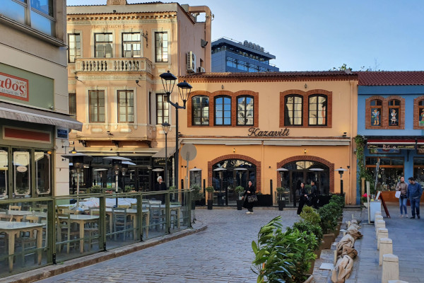 A picture showing the distinctive architecture of the buildings and some tavernas at Ladadika, Thessaloniki.