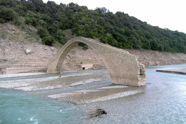 A picture of the Manolis Bridge in Agrafiotis River that is visible as a whole, only during the summer season.