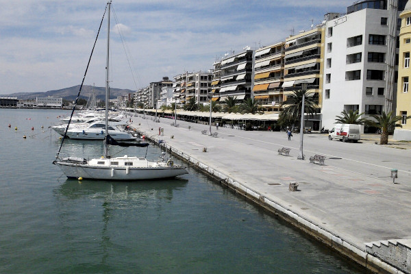 Sailing boats anchored by the wide seafront promenade of Volos.