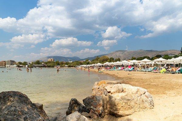 A photo showing the Asteras (Astir) Beach of Vouliagmeni,  Attica.