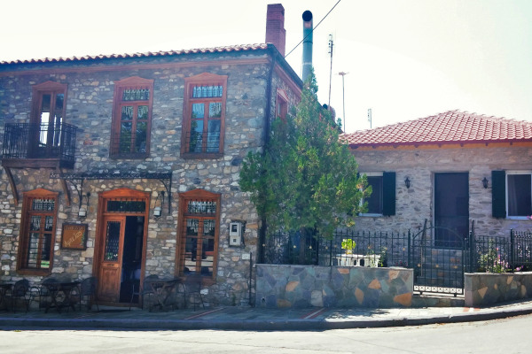 A traditional stone-built building that houses a taverna opposite to the central square of Vrasna.