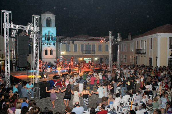 People dancing in front of a concert stage celebrate the Old-Town Festival of Xanthi.