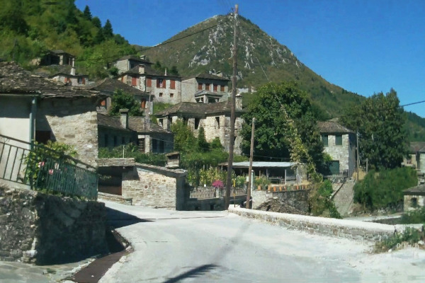 The central road and some buildings of the traditional village of Dikorfo in the Zagori region.