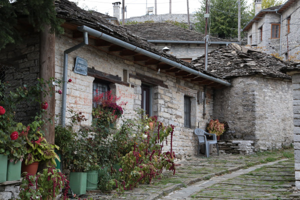 A close up photo of an old stone-built traditional house of Kapesovo village in the Zagori area.
