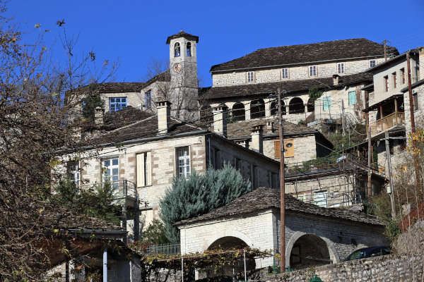 A close up picture of some buildings of the central part of Kipoi village, including the church.