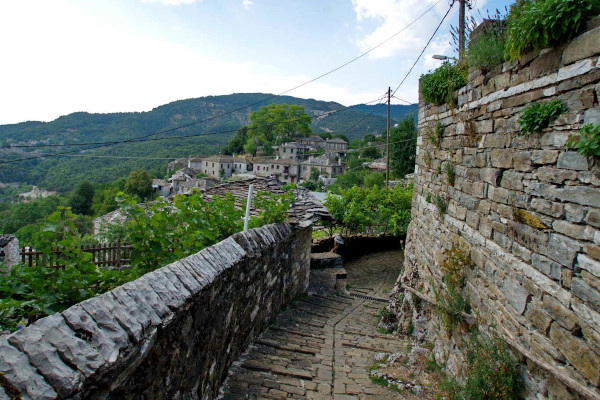 A narrow traditional cobble-stoned path inside the village of Mikro Papingo.