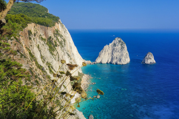 The two Mizithres Rocks just below the steep cliffs of Keri Cape on the island of Zakynthos.