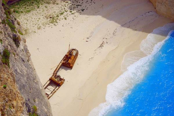 A photo taken from the top of the cliff showing the shipwreck beach on the island of Zakynthos.